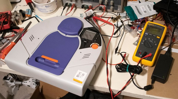 Neato charging experiments on workbench