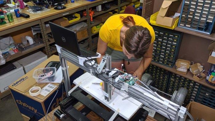Emily rigging up Sharpie holder for Grbl ESP32 Z axis servo